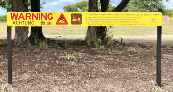 Signage warning of crocodiles.